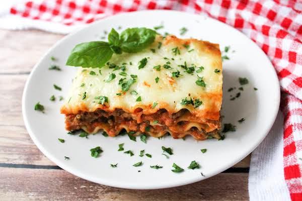 Slice Of Lasagna On A Plate.