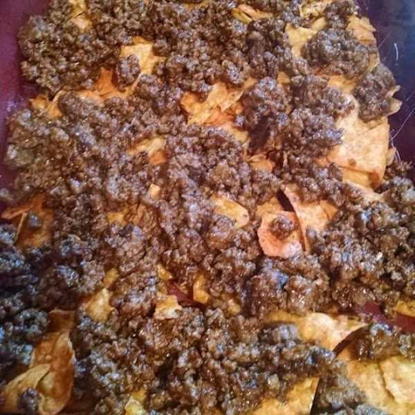 Layer meat over Doritos
