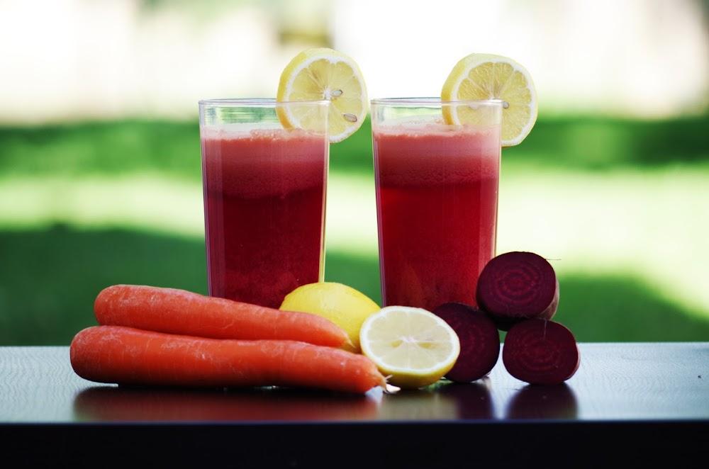 carrot-fruit-beside-lemon-fruit-on-black-wooden-table-161440