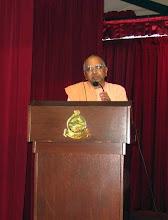 Photo: Swami Muktirupananda, President of Ramakrishna Mission Singapore, giving a speech.