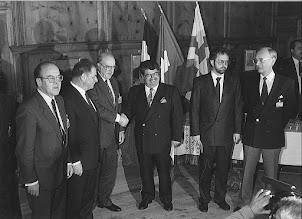 """Photo: DAVOS/SWITZERLAND, 31JAN 1988 - The Davos Declaration, a historic handshake between the Turkish and Greek Prime Ministers. (fltr) Kurt Furgler, Chairman of the Annual Meeting; Jean-Pascal Delamuraz, Swiss Federal Councillor; Prime Minister Andreas Papandreou of Greece; Prime Minister Turgut Özal of Turkey; Luzius Schmid, Mayor of Davos; and Klaus Schwab captured at the Davos Town Hall during the European Management Forum, the predecessor of the World Economic Forum in Davos in 1988.  Copyright <a href=""""http://www.weforum.org"""">World Economic Forum</a> (<a href=""""http://www.weforum.org"""">http://www.weforum.org</a>)"""