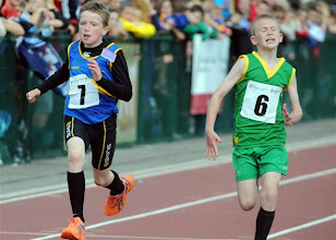 Photo: David Ryan driving for the line in the Boys U/12 100m