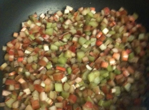 Place rhubarb and water into a large pot or skillet and cook on high...