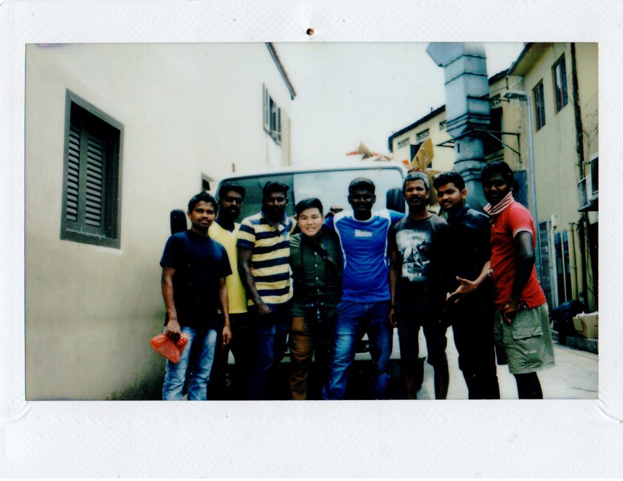Migrant Friends and I in front of a lorry