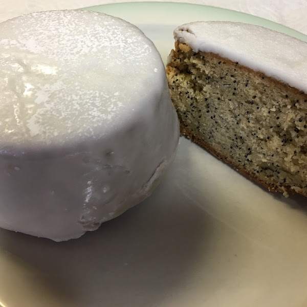 Poppyseed Cake with Lemon Glaze. It is an oversized muffin or large personal cake.