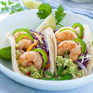 Shrimp Tacos with Tomatillo Guacamole and Cilantro Lime Slaw.
