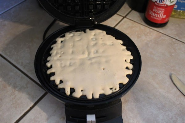 Pour a little over one cup into your Belgian waffle maker. Cook for 4...