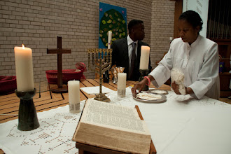 Photo: Acolytes and ushers prepare the communion before the service.
