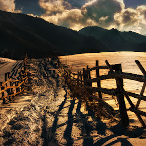 by Veronica Gafton - Landscapes Mountains & Hills ( path way hill mountain mountains fence day clouds sun shadows perspective landscape winter snow )