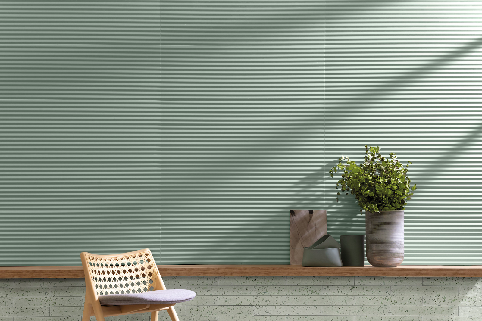 Mint green tile in a 3D ridged design and a terrazzo-look design