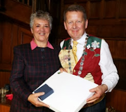 Photo: INIB Secretary, Caroline Thomson receiving her print and The Culture of Bees paperweight from Bill
