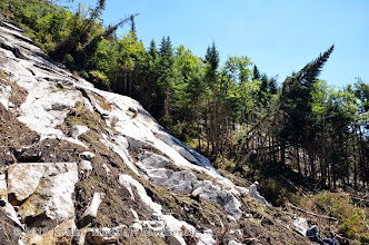 Photo: NP sitting on the first dominant outcrop of the northern side.
