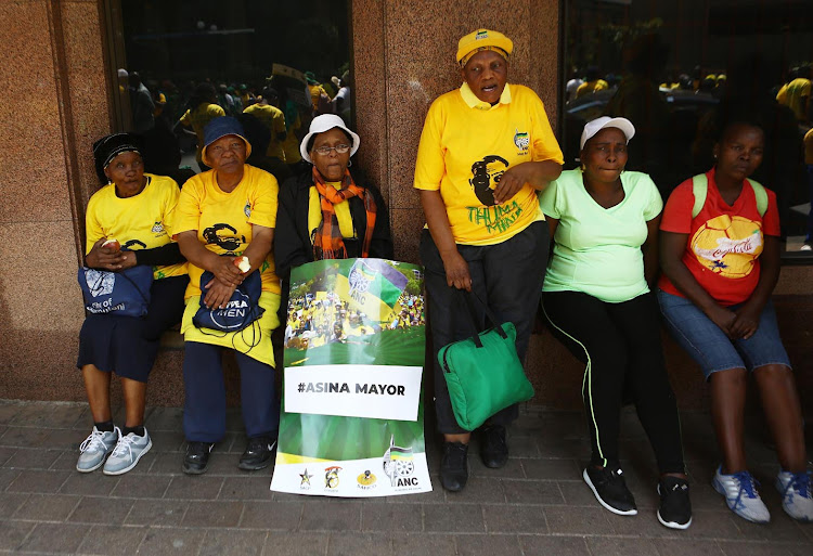 ANC members take a break during a march to the offices of Mayor Herman Mashaba and Eskom to handover a memorandum demanding service delivery on October 5 2018