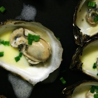 Poached Oyster with Cream and Champagne.