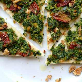 Pizza With Rocket Pesto, Hazelnuts And Sundried Tomatoes