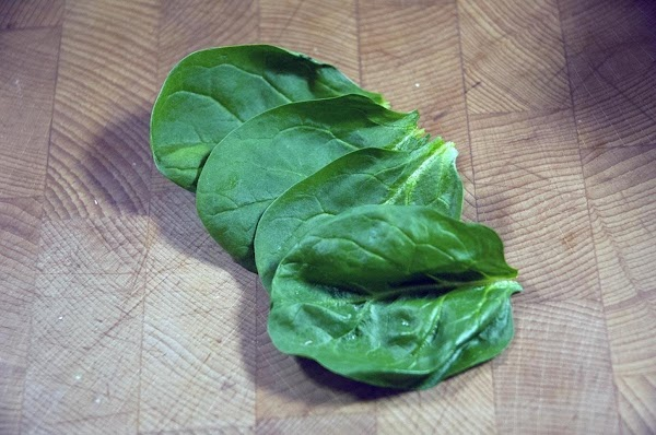 Pick four good-sized spinach leaves and reserve.
