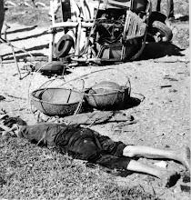 Photo: BÊN THẮNG CUỘC - HUY ĐỨC                              Thi thể bị đứt đoạn của một người dân Việt Nam đã thiệt mạng khi chiếc xe lam ba bánh cán trúng mìn Việt Cộng ở Mai Hương nằm gần cạnh các giỏ thúng hàng hóa mang ra chợ của thành phố. Các bộ phận hủy hoại của xe lam nhìn thấy trong nền ảnh. http://www.vietnam.ttu.edu/virtualarchive/items.php?item=VA004346 The broken body of a Vietnamese villager who was killed when a scooter bus hit a Viet Cong mine in Mai Huong lies near the baskets in which he was carrying produce to market to the provincial capital. Parts of the wrecked scooter can be seen in the background.