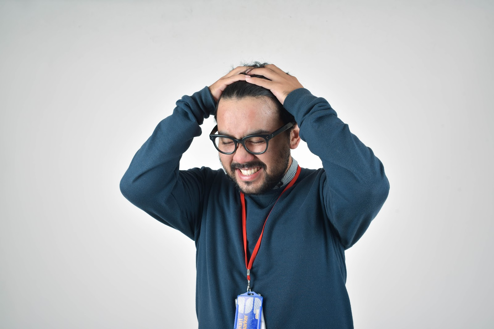 man holding his head, visibly stressed out