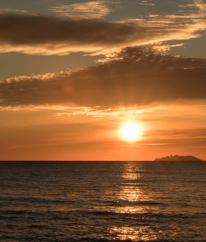 sole e nuvole sul mare di kofi