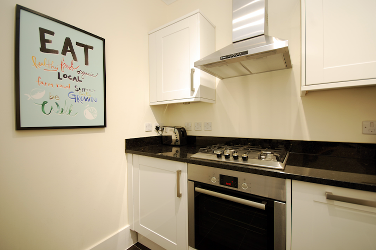 Fully equipped kitchen at Oxford Street Apartment, London