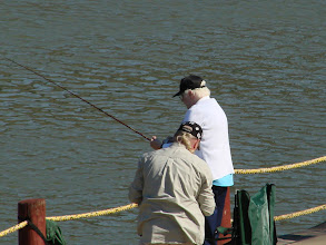 Photo: Couple of guys fishing at the barge.