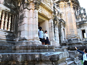 Photo: students on a fieldtrip taking pictures at Phimai Historical Park