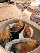 Oysters with citrus ice served with white merlot.