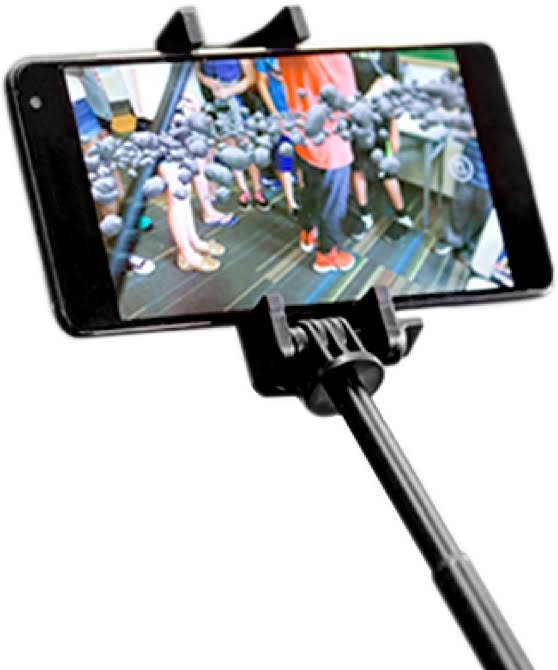 Mobile phone on a selfie stick showing the Expeditions app. Students are exploring an augmented reality asteroid field.