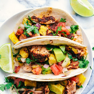 Grilled Spicy Blackened Salmon Tacos with Pineapple Avocado Salsa.