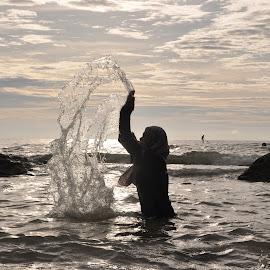 Feel It by Etty Selamat - Uncategorized All Uncategorized ( water, sunset, beach, people, rocks,  )