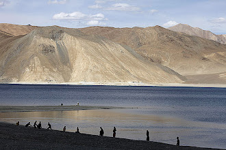 Photo: People stand by the banks of the Pangong Lake, near the India-China border in Ladakh. (AP)