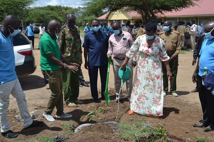 Kitui West MP Edith Nyenze water a tree seedling she planted during the launch of the Greening Empty spaces inititive at Ndolo's Corner in her constituency on Friday.