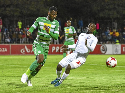 Released Bloemfontein Celtic defender Alfred Ndengane, left, is said to be joining Pirates.
