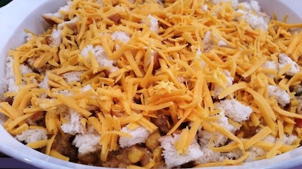 Pour the mixture into prepared casserole and sprinkle with torn bread pieces and sprinkle...