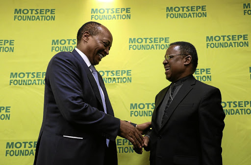 Chairperson of the Motsepe Foundation Patrice Motsepe, left, have a word with Reverend Frank Chikane during an announcement of the National Day of Prayer in Sandton, Johannesburg, yesterday.