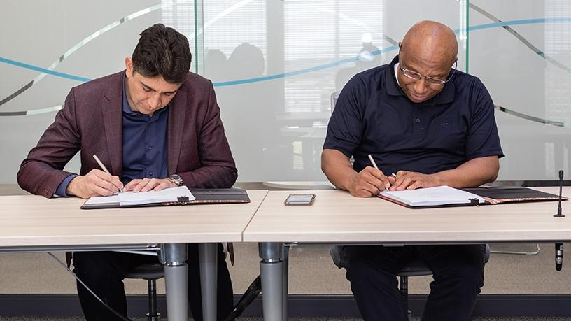 Vodacom CEO Shameel Joosub and Telkom CEO Sipho Maseko put pen to paper on a new multi-billion-rand roaming deal.