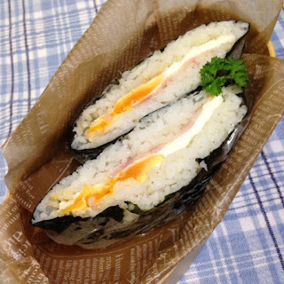 Rice sandwich with bacon and egg Onigirazu