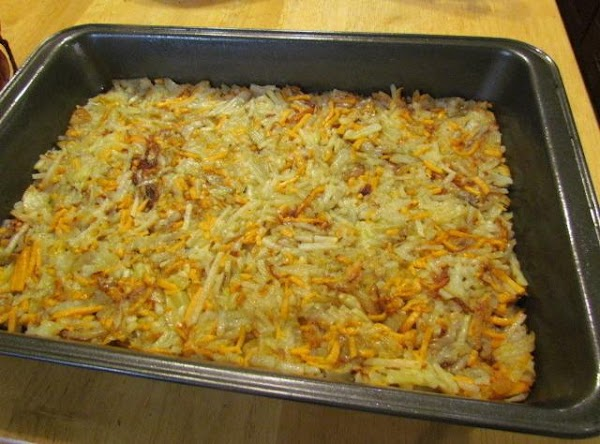 Start layering up your ingredients: Potatoes cheese sausage eggs scallions & pepper mix Bacon top with more cheese