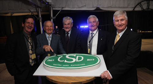Cutting the CSD 50th birthday cake at last night's celebratory dinner, CSD chairman James Kahl, inaugural chairman, Frank Hadley, original board members Ralph Schulze and John Grellman, former chairman, and CSD managing director Peter Graham.