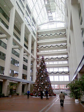 "Photo: This is a view inside the ten story glass atrium. That Christmas tree (it is *not* a ""holiday tree"") is forty feet high. The atrium is open to the public; there's a small museum inside."