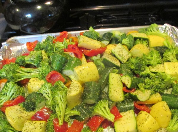 Cut and wash veggies, and dry with paper towel, then spread evenly on a...