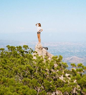 woman top of mountain