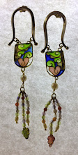 Photo: Plique-à-Jour Enamel Jewelry - Earrings - Hear Plant - Fine Silver, 18K Gold, Plique-a-Jour Transparent and opalescent enamels, agate beads, carved tourmaline leaves, cultured pearls - approximately 12mm (w) x 87mm (h) - $1150.00 US (Posts are 18K gold.) Photo shows earrings when backlit.