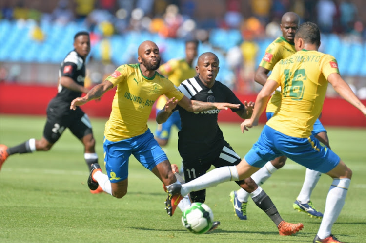 Orlando Pirates' mdifielder Luvuyo Memela tries to get away from his markers during the Absa Premiership match against Mamelodi Sundowns at Loftus Versfeld Stadium on January 13, 2018 in Pretoria, South Africa. Pirates 3-1.