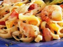 Add the fettuccini and gently toss to coat pasta. Pour the mixture into a...