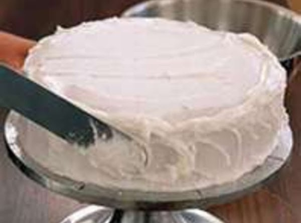 ***************Assembly**************************Take cakes from freezer and place first layer on cake pedastal or plate. Frost...