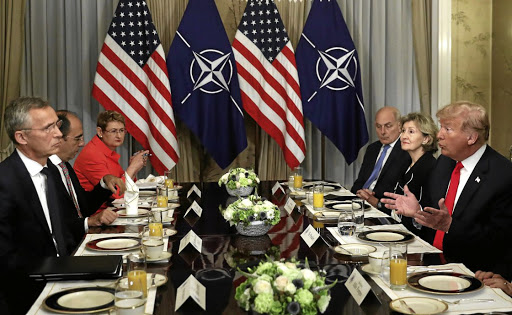 US President Donald Trump holds a breakfast meeting with Nato Secretary-General Jens Stoltenberg, left, at the Nato Summit in Brussels, Belgium, on July 11 2018. Picture: REUTERS