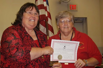 Photo: Sharon Robinson receiving her Past Madam President certificate and Gold Card.