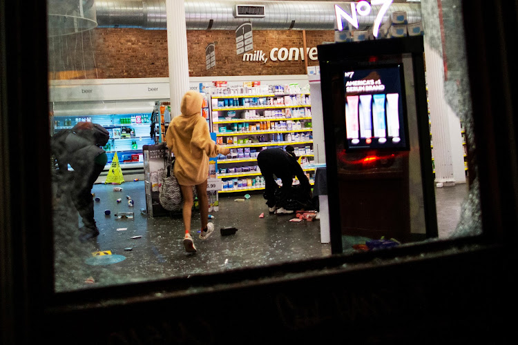 Protesters loot a store after marching against the death in Minneapolis police custody of George Floyd, in the Manhattan borough of New York City on Monday.