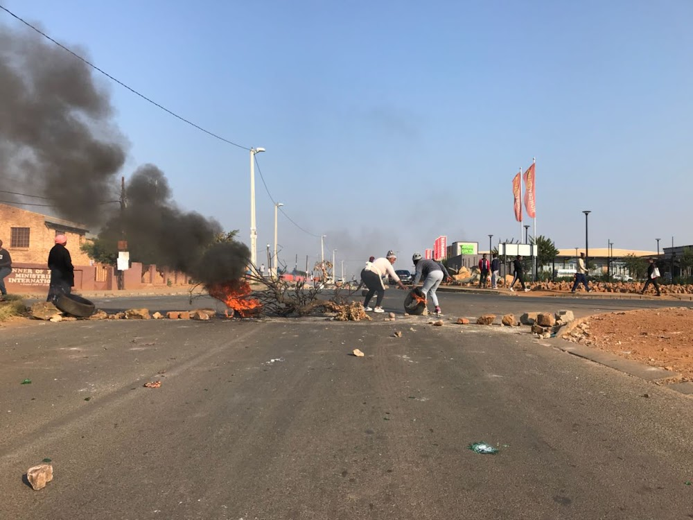 Police Monitor Soweto Protests